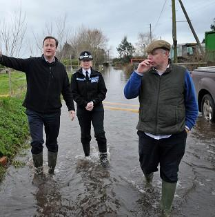 Braintree and Witham Times: Prime Minister David Cameron with Bridgwater and West Somerset MP Ian Liddell-Grainger (right) during a visit to Goodings Farm in Fordgate, Somerset