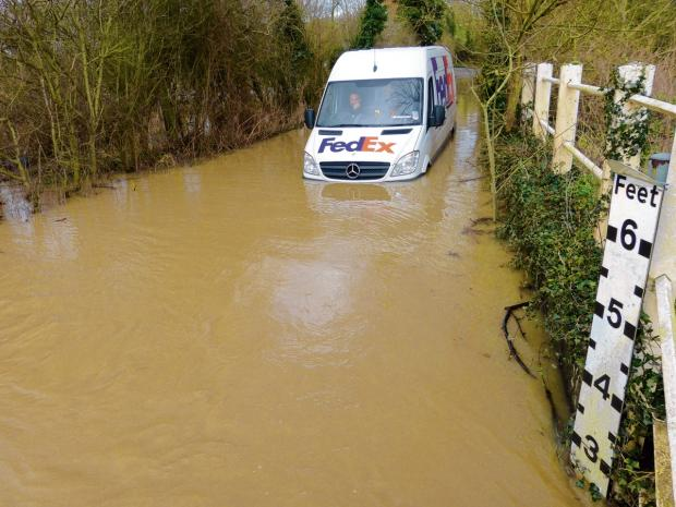 A van driver stuck in flood water in Shalford (Photo: John Parish)