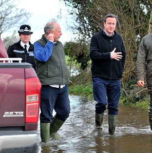 Prime Minister David Cameron with Bridgwater and West Somerset MP Ian Liddell-Grainger during a visit to Somerset