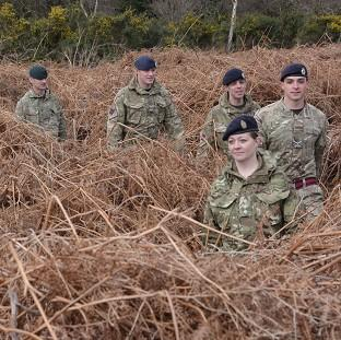 Braintree and Witham Times: Soldiers led by Army reservist Captain Leanne Christmas march along the front line trench of a newly discovered First World War practice battlefield in Gosport, Hampshire