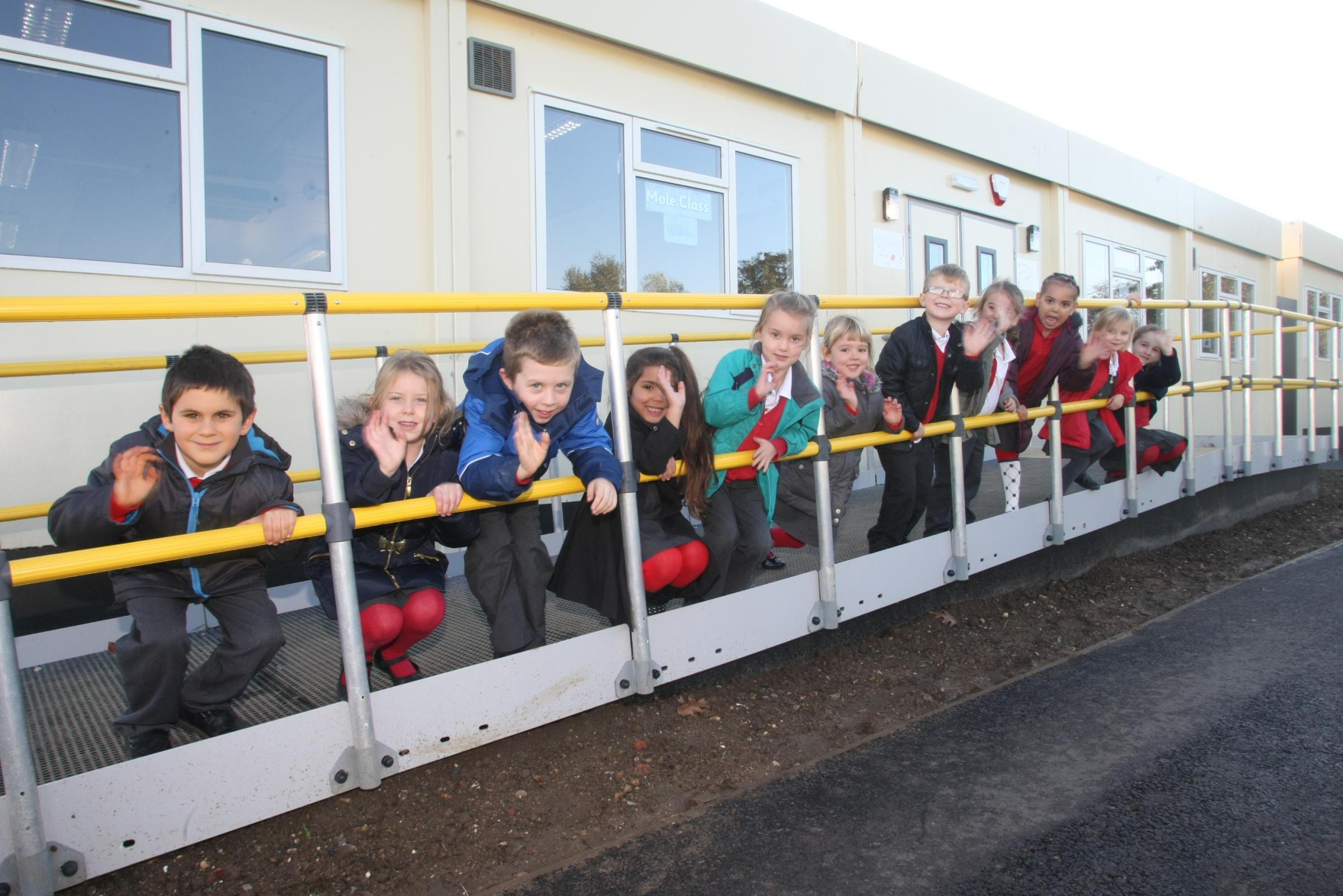 Pupils outside one of the demountable classrooms the school is currently based in