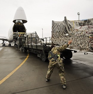 Equipment being loaded into a plane bound for the UK after being recovered from closed down Army bases in Helmand province, Afghanistan