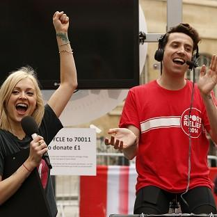 Braintree and Witham Times: BBC Radio 1 breakfast show host Nick Grimshaw is joined by Fearne Cotton as he conducted his entire show from a bike as part of his Sport Relief challenge