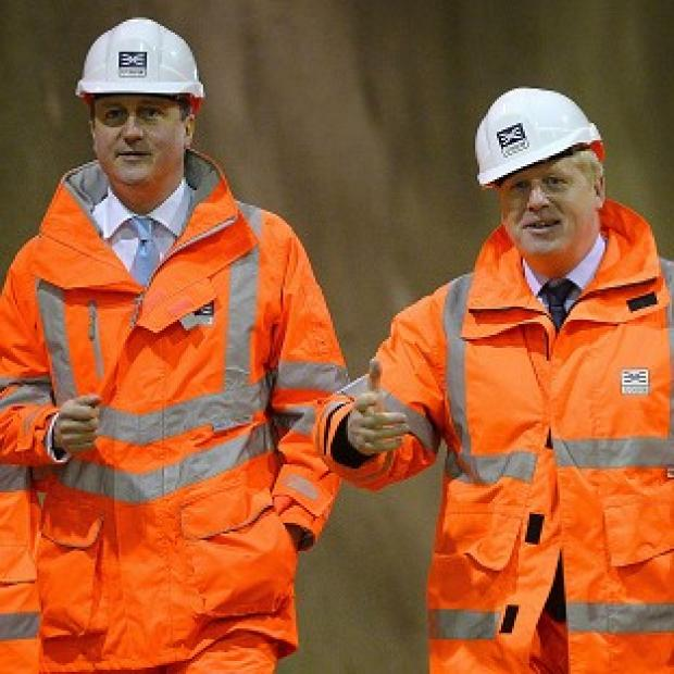 Braintree and Witham Times: David Cameron (left) and Boris Johnson visiting a construction site. The PM wants the London Mayor to return to Parliament