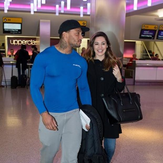 Braintree and Witham Times: Kelly Brook with her reported fiance David McIntosh at Heathrow Airport