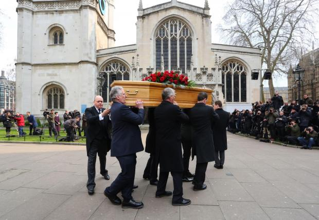 Tony Benn's coffin is carried into St Margaret's Church, Westminster