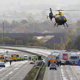 Emergency services work at the scene on the M5 motorway close to T
