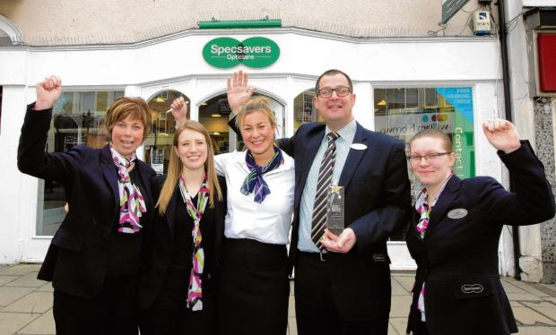 Specsavers staff celebrate top award.