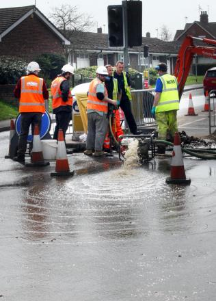 Busy junction flooded after workmen damage water main