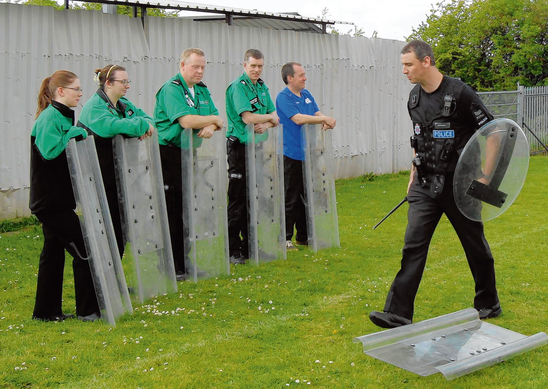Sgt Martin Richards giving riot training to youngsters taking part