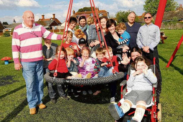 Swinging time as village's new play area opens