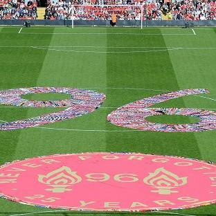 Fans' scarves make up a 96, filling the centre circle before the Hillsborough 25th Anniversary Memorial Service at Anfield Stadium, Liverpool