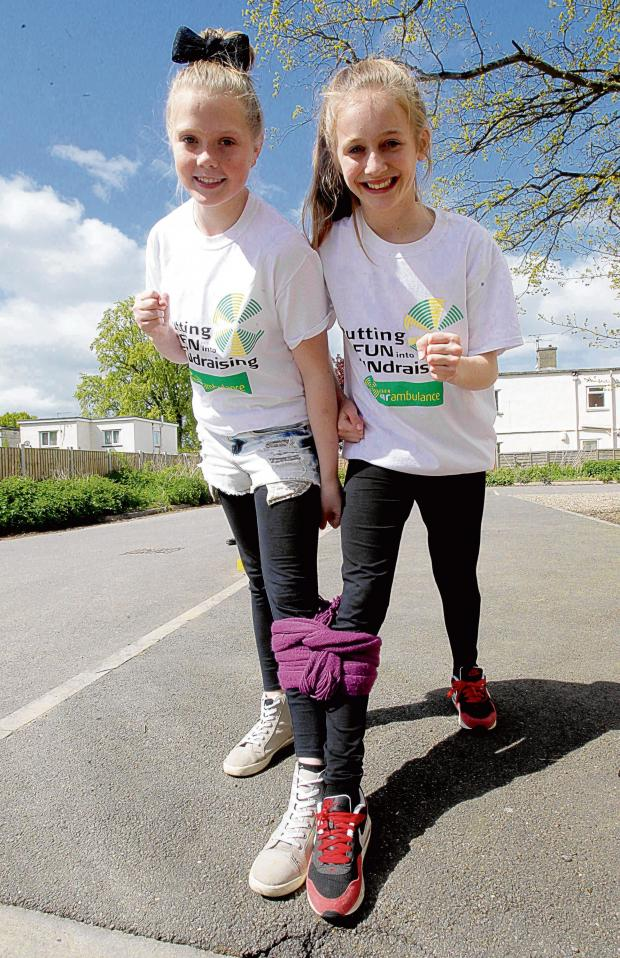 Braintree and Witham Times: Three legged walk raises £900 for air ambulance