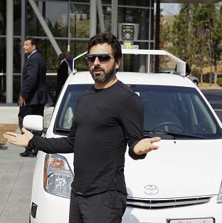 Google co-founder Sergey Brin with a driverless car in Mountain View, California