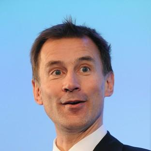 Health Secretary Jeremy Hunt was accused of giving money to senior NHS managers rather than frontline staff