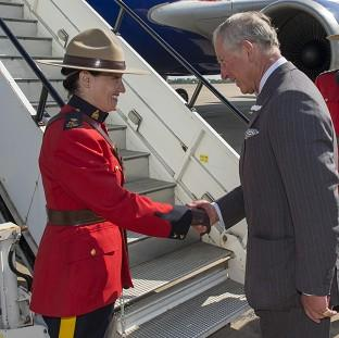 Braintree and Witham Times: The Prince of Wales shakes hands with Canadian protection officer, Police Inspector Marie-Claude Cote on departure from RAF Brize Norton in Oxfordshire