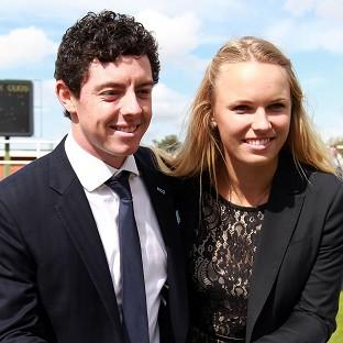 Braintree and Witham Times: Golfer Rory McIlroy with former fiancee and tennis player Caroline Wozniacki in 2012