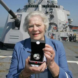 Braintree and Witham Times: Lady Mary Soames, daughter of Sir Winston Churchill, has died aged 91. She is pictured holding a coin commemorating her father aboard the USS Winston S Churchill which was docked in Portsmouth.