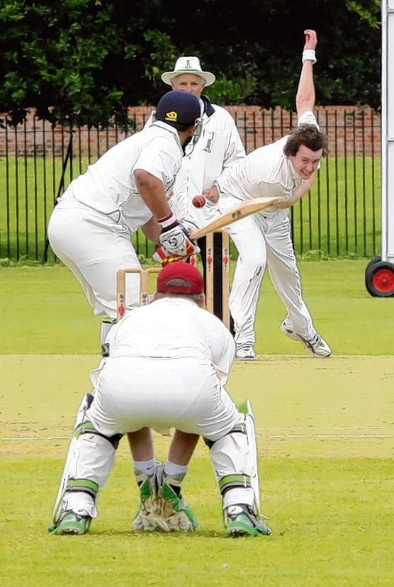 Matt McKendry bowls for Witham against Haverhill. Pictu