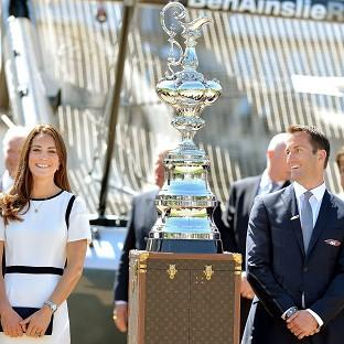 Braintree and Witham Times: The Duchess of Cambridge with Sir Ben Ainslie in front of the America's Cup during a visit to the National Maritime Museum, London