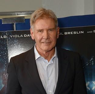 Harrison Ford is being treated in hospital for an ankle injury, a spokesman said (AP)