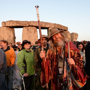 Crowds gather at dawn amongst the stones at Stonehenge in Wiltshire for the Summer Solstice.