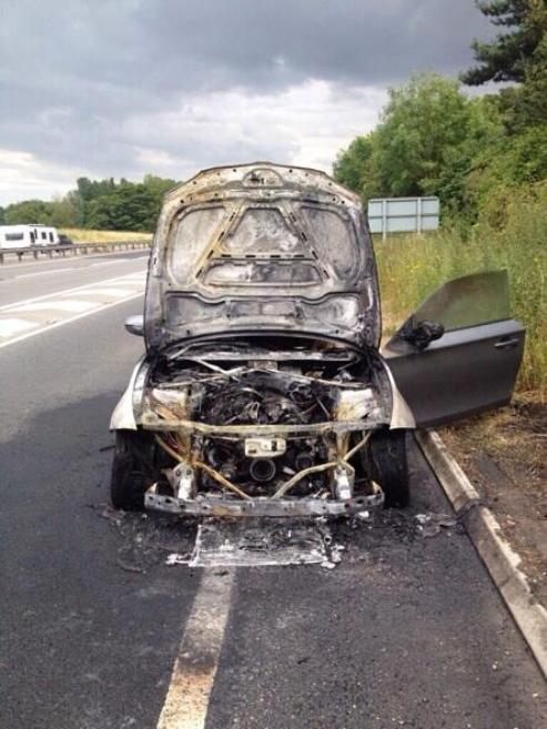 Car destroyed by fire on A12 slip-road