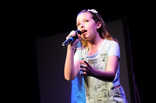 Young singer hits the right notes to get into final