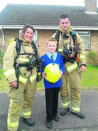 Schoolboy is praised for raising the alarm after bungalow fire
