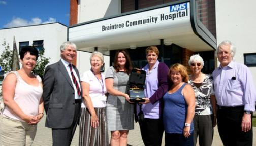 Braintree school welcomes new defibrillator after hospital shop raises cash