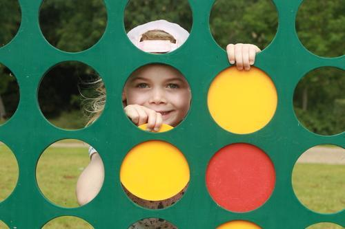 Children have fun with giant outdoor games