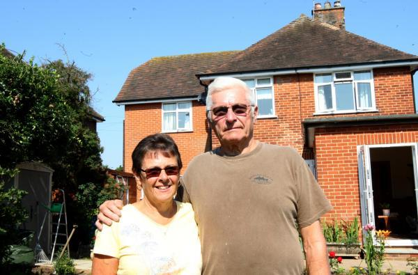 Susan and Peter Wood outside their home