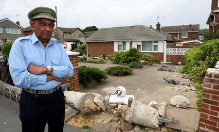Pensioner builds steel and concrete barrier to protect home from speeding cars