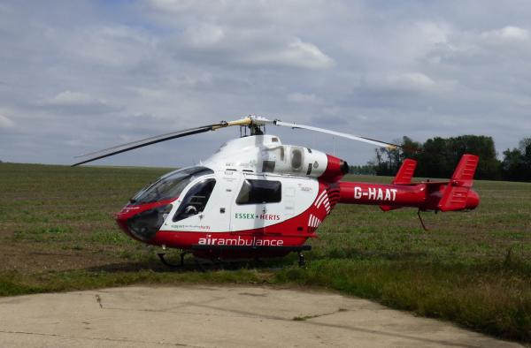 The air ambulance landed in a field to the rear of Shalford Road (Pic by Peter Crosby)