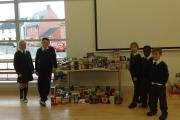 Pupils at Flitch Green Academy near Dunmow with the food they collected for the foodbank