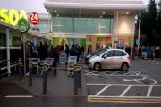Shoppers waiting outside Asda this morning