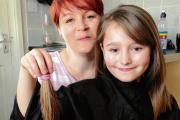 Schoolgirl raises at least £800 for charity by chopping her locks