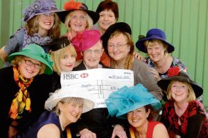 High-class head wear auctioned off to raise hundreds for hospice