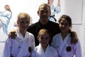 Grading glory for black belt trio