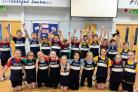 The victorious Howbridge School indoor athletics team.