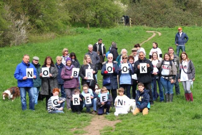 Villagers against plan for 1,600 new homes go on three mile walk to promote their objections