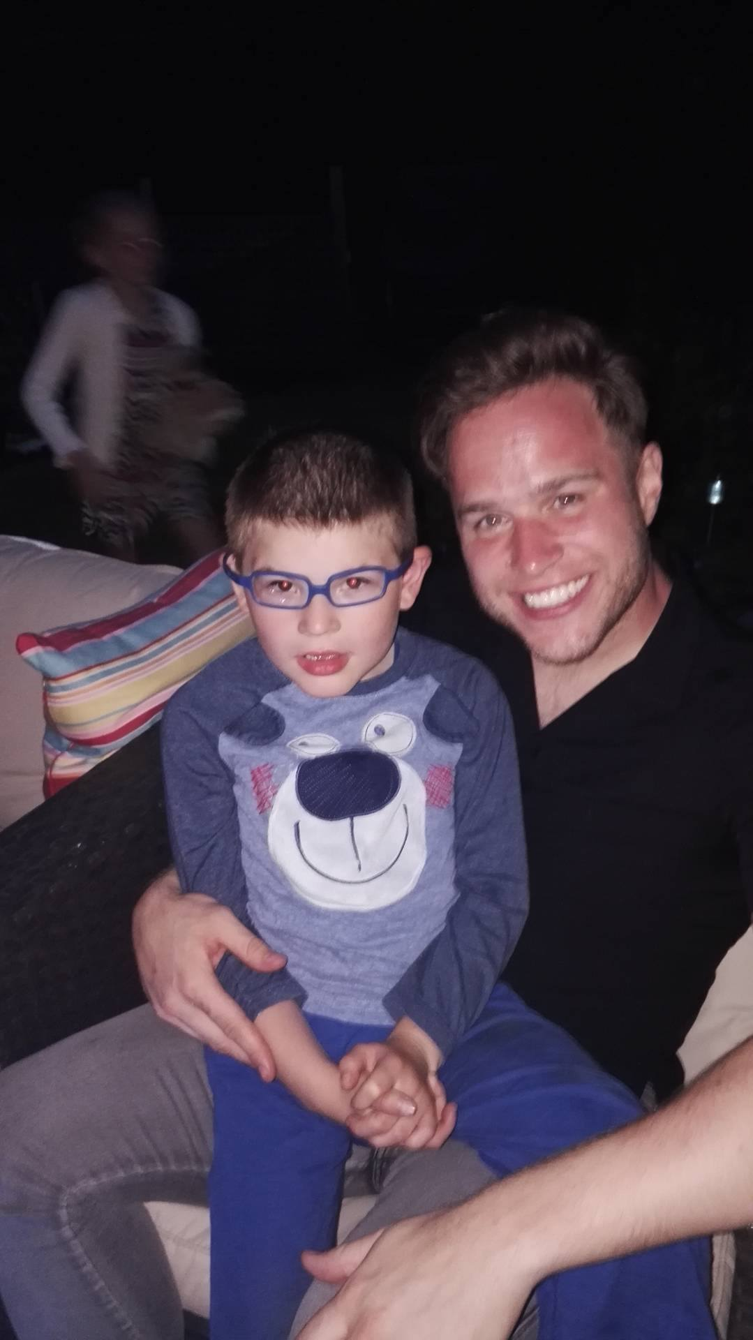 PALS: Alfie met X Factor star Olly Murs at a charity BBQ this year