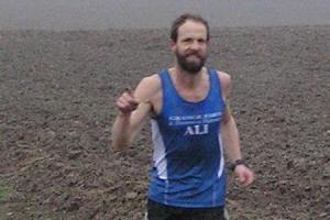 Alistair Brown finishes strongly for Grange Farm and Dunmow Runners in the Mid-Essex Cross-Country League.