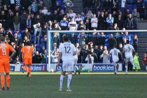 Ben McNamara makes a penalty save for Braintree in the second half at Tranmere Rovers. Picture: Alan Stuckey