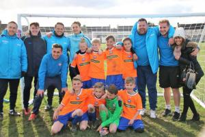 The Lyons Hall Primary School youngsters enjoy their success with coaches from Community Iron and the Braintree Town Academy.