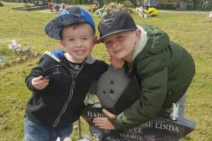 BROTHERS: Cairo and Theodore Reeve at their sister Harper's grave
