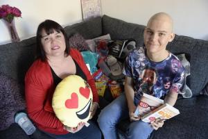 Charlie Corbett, 14, diagnosed with Leukemia, together with mum Lisa, collecting items for Cancer patient parcels at their home in Witham.