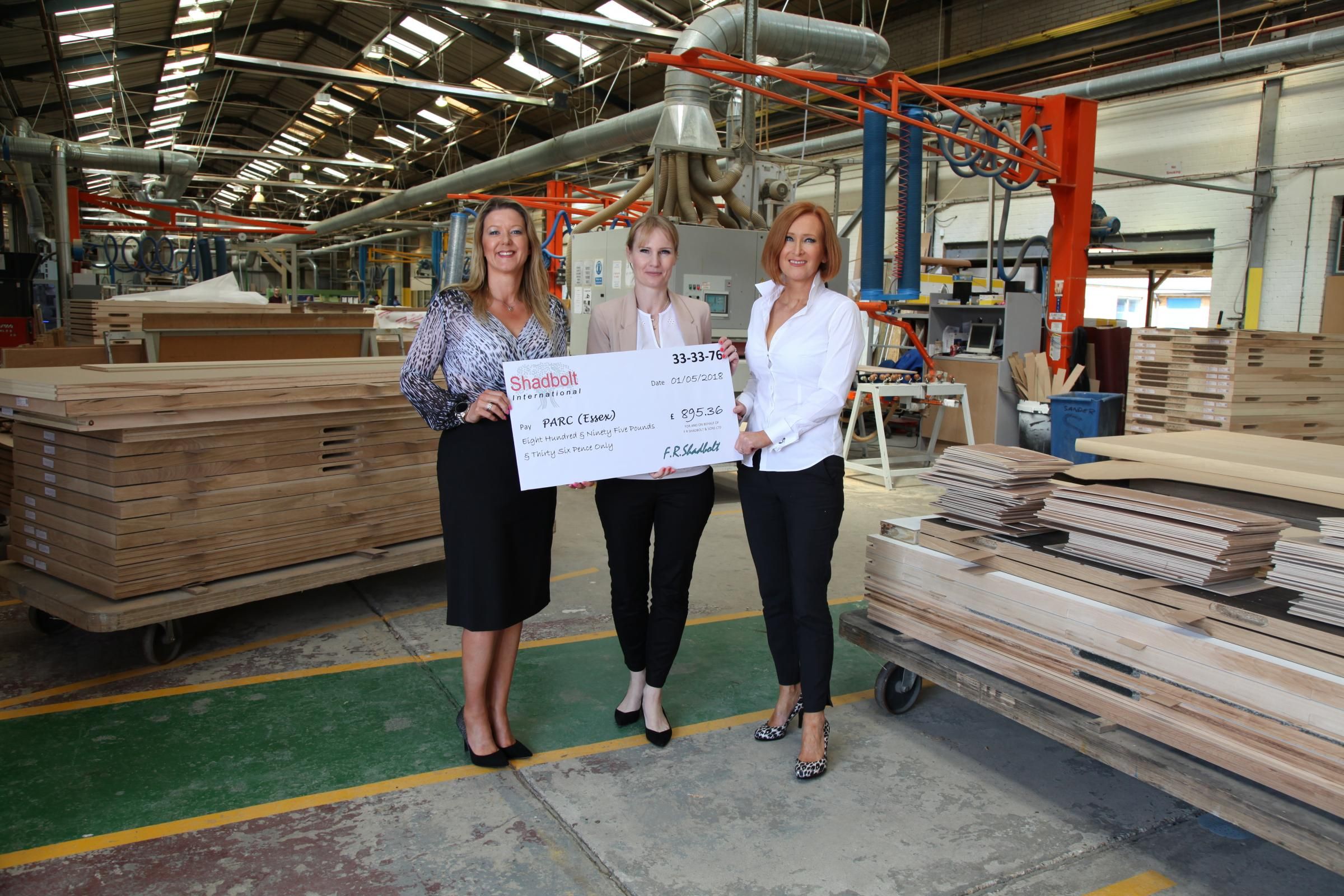 DONATION: Amanda Farrow and Angie Rains handing the cheque over to PARC representative Friederike Walter