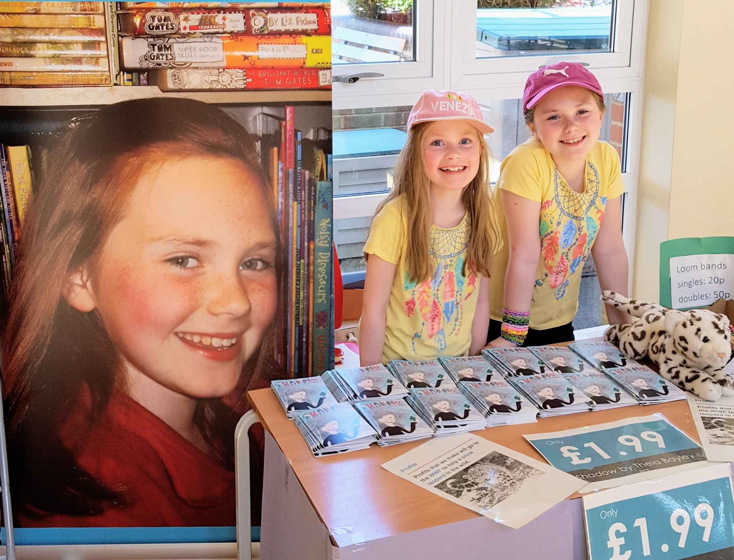 CHARITABLE: Raphaela Bayley and author Theia selling the book at Bocking Church Street Primary School