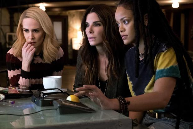 Braintree and Witham Times: Undated film still handout from OceanÕs 8. Pictured: Sarah Paulson as Tammy, Sandra Bullock as Debbie Ocean and Rihanna as Nine Ball. See PA Feature SHOWBIZ Film Reviews. Picture credit should read: PA Photo/Warner Bros. Entertainment Inc./Barry Wetcher.